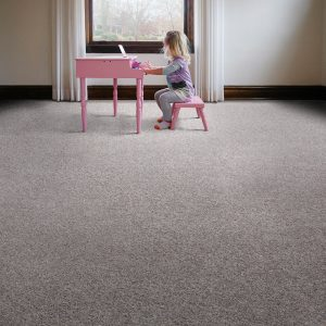 Girl playing piono on carpet flooring | Mill Direct Floor Coverings