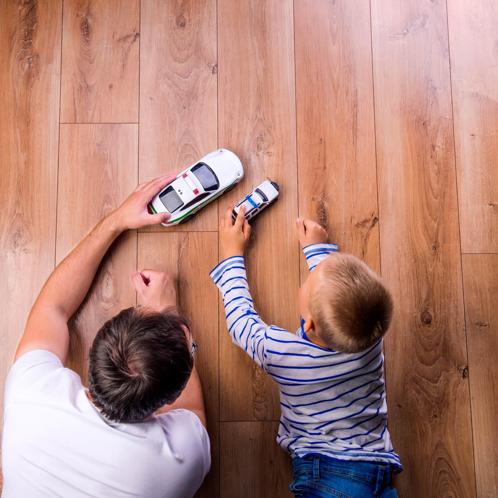 Father and kid playing with toycar | Mill Direct Floor Coverings