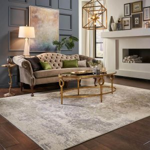Coffee table on area rug | Mill Direct Floor Coverings