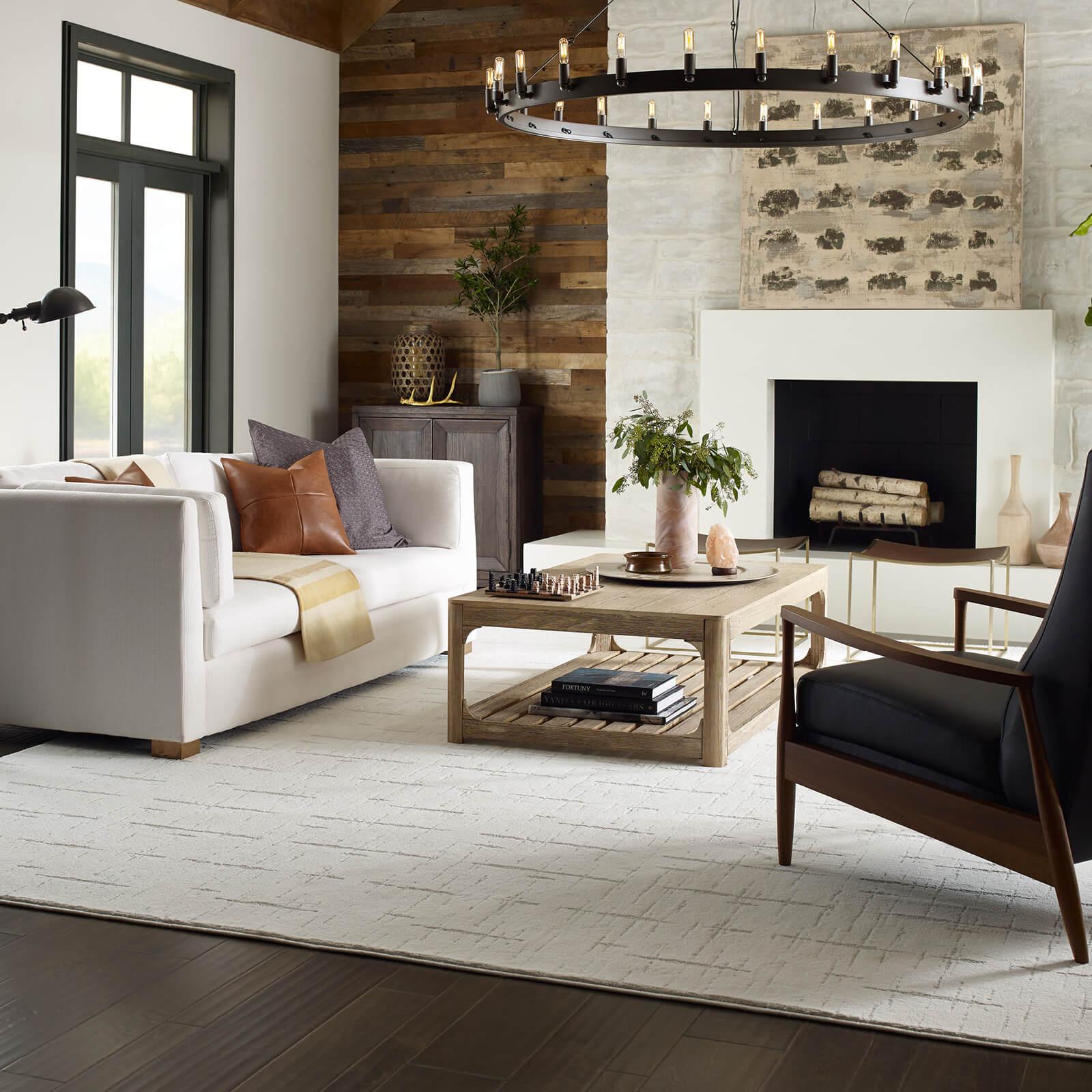 custom area rug in living room | Mill Direct Floor Coverings