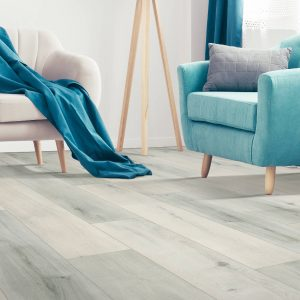 laminate flooring with blue accent chair | Mill Direct Floor Coverings