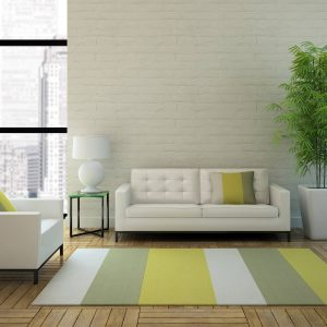 striped yellow and green area rug in apartment | Mill Direct Floor Coverings