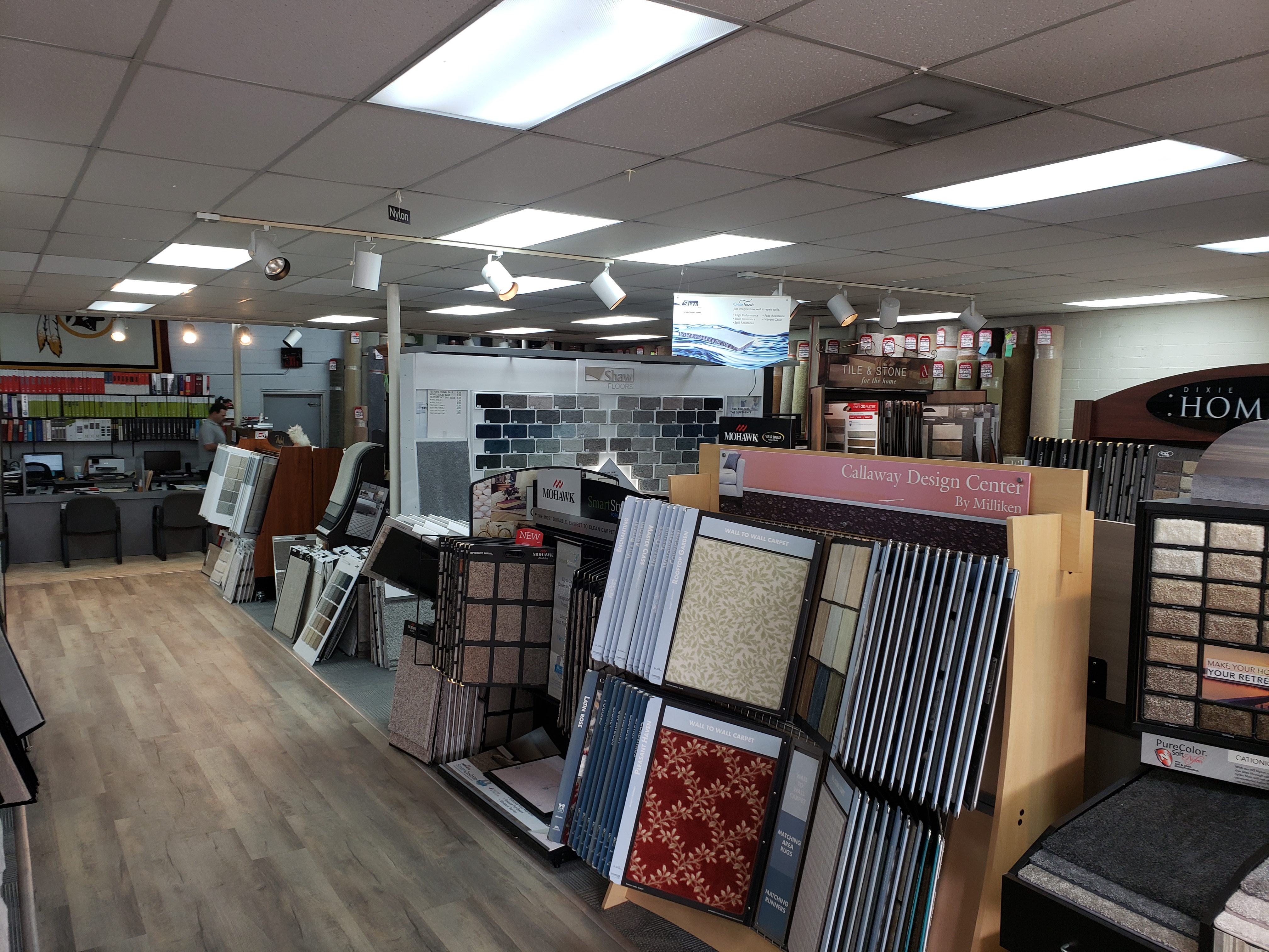 Variety of flooring products in showroom | Mill Direct Floor Coverings